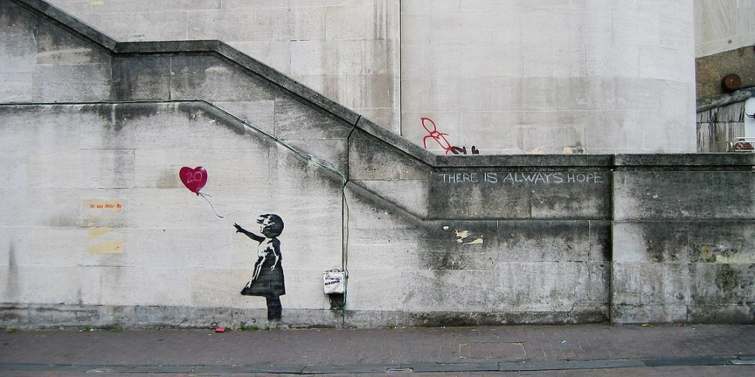 1200px-Banksy_Girl_and_Heart_Balloon_(2840632113)